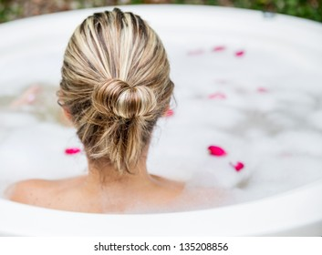Woman taking a bubble bath - beauty concepts
