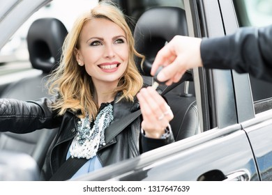 Woman taking car keys