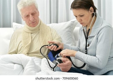 woman taking care of ill man