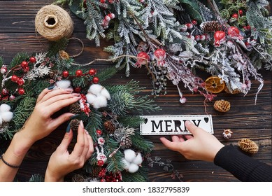 Woman taking care of ornament. Top view of christmas festive frame with new year decorations.