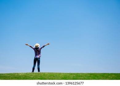 Woman taking deep breath in the meadow