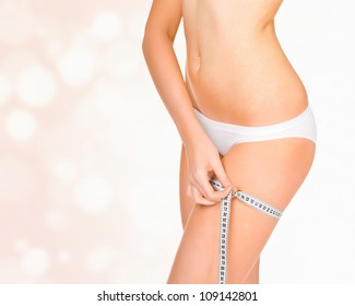 Woman taking measurements of her body, abstract background with circles and copyspace