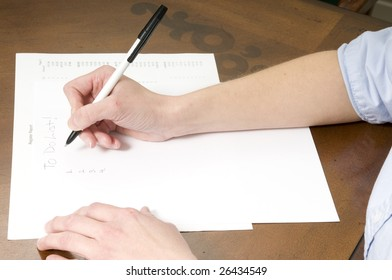 woman taking notes or making a to do list