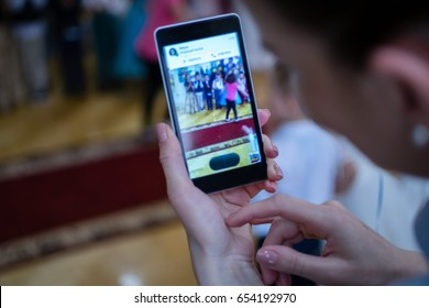 Woman taking photo with cell phone - Blur