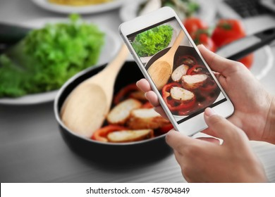 Woman taking photo of food. Food blogger concept