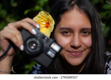woman taking pictures with analog camera