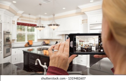 Woman Taking Pictures of A Custom Kitchen with Her Smart Phone.