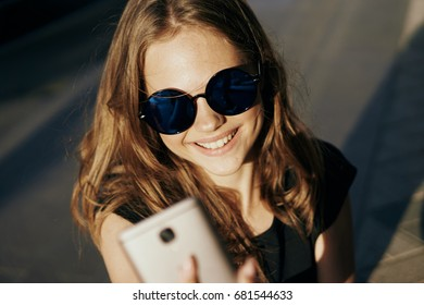 Woman is taking pictures of herself on the phone