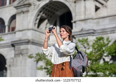 Woman taking pictures while traveling on vacation