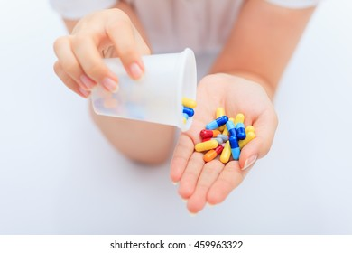 woman taking pills.