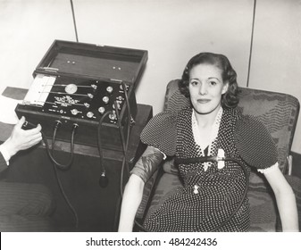 Woman taking a polygraph test