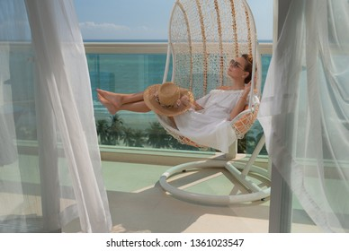 Woman taking rest in hotel terrace over sea view