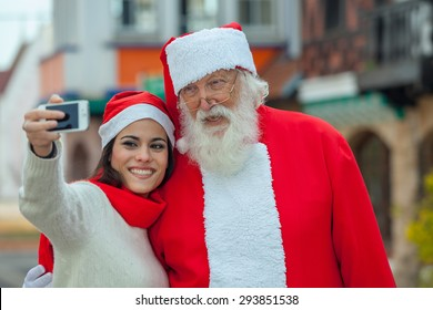woman taking a selfie with santa