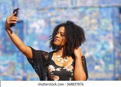 Woman taking a selfie stock image