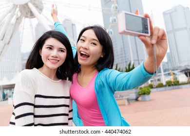 Woman taking selfie together in Hong Kong