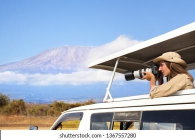Woman taking shots during Kenyan safari game drive