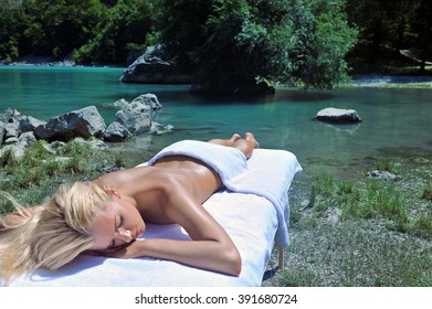 woman taking sun and  relaxing by the lake