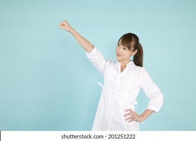 The woman taking a victory pose