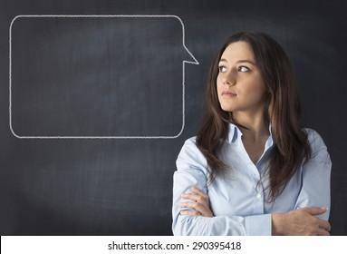 Woman with talking bubble on blackboard.