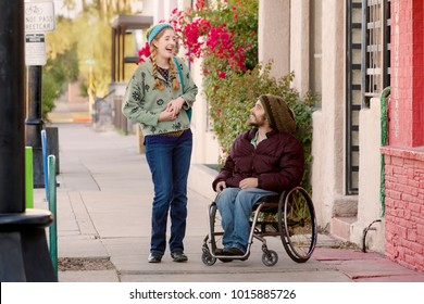 Woman talking with friend in wheelchair