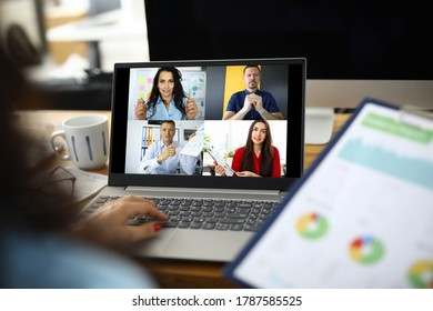 Woman talking with international colleagues using online video chat service at workplace closeup - Shutterstock ID 1787585525
