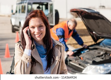 Woman talking on cellphone after car breakdown trouble problem mechanic