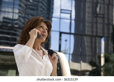 A woman talking on her cell phone in a city.