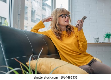 woman talking on the mobile phone with the hands-free