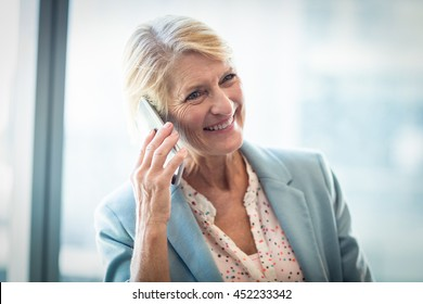 Woman talking on mobile phone in the office