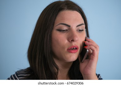 woman talking on the phone on blue background