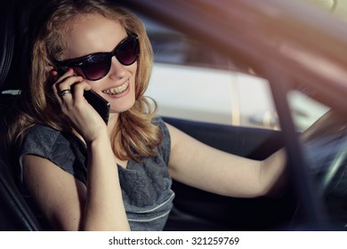 Woman talking on the phone in the car