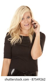 a woman talking on the phone with a shocked expression on her face.