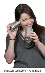 A woman talkng on a primative phone