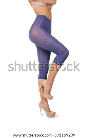 c23d665e1813e Woman tall legs with blue purple violet stockings pantyhose shorts isolated  on white high heels without panties - Image
