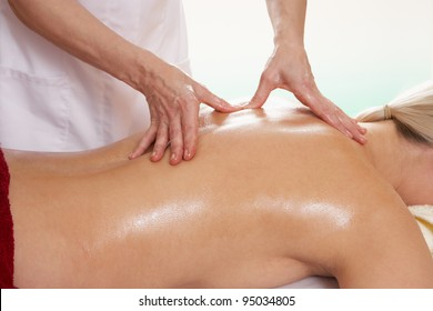 Woman with tattoo having back massage