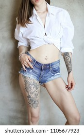 Woman with tattoo on a leg