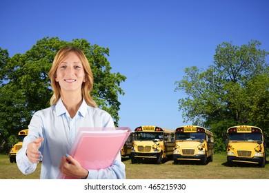 Woman teacher with school bus