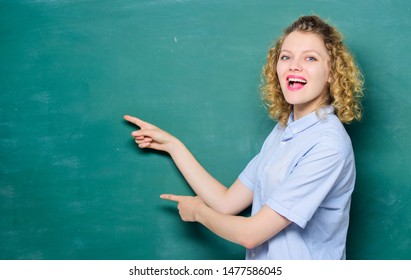 woman teacher at school lesson. university or college life. back to school. woman likes studying. knowledge day. empty blackboard information. happy student at blackboard. copy space. Teachers day.