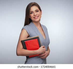 Woman teacher or student holding red and gray books. isolated portrait.