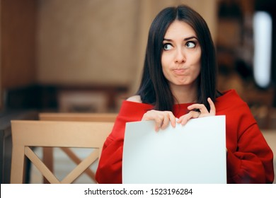 Woman Tearing Up Documents in a Restaurant. Angry girl destroying a contract in impulsive reaction