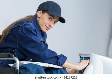 woman technician fixing an appliance