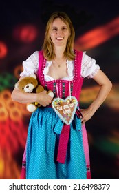 Woman with teddy and gingerbread at fun fair