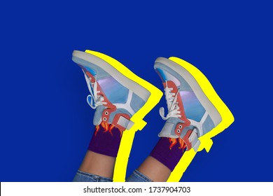 Woman or teenager legs in shoes or boots. Creative fashion footwear design with blue background.