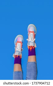 Woman or teenager legs in shoes or boots. Creative fashion footwear design background.