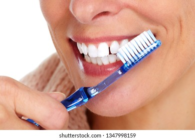 Woman teeth with toothbrush.