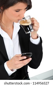 Woman with telephone and coffee