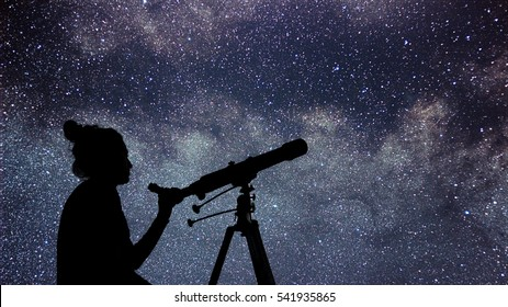 Woman with telescope watching the stars. Stargazing woman and night sky.