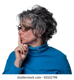 Woman telling people to be quiet, finger on lips