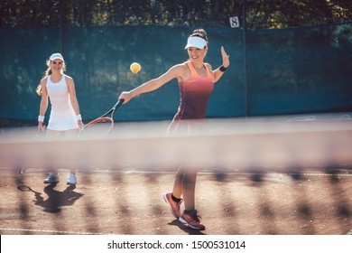 Woman in a tennis double on a sunny day