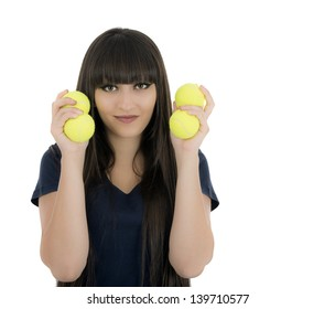 Woman tennis player holding a racket and balls, isolated on a white background.